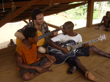 Martin jamming with the Baka in their music house in Cameroon