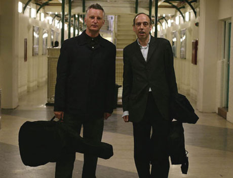 Billy Bragg and Mick Jones, of The Clash, deliver guitars to Wormwood Scubs prison. 05-07-2007. Photograph by Martin Godwin.